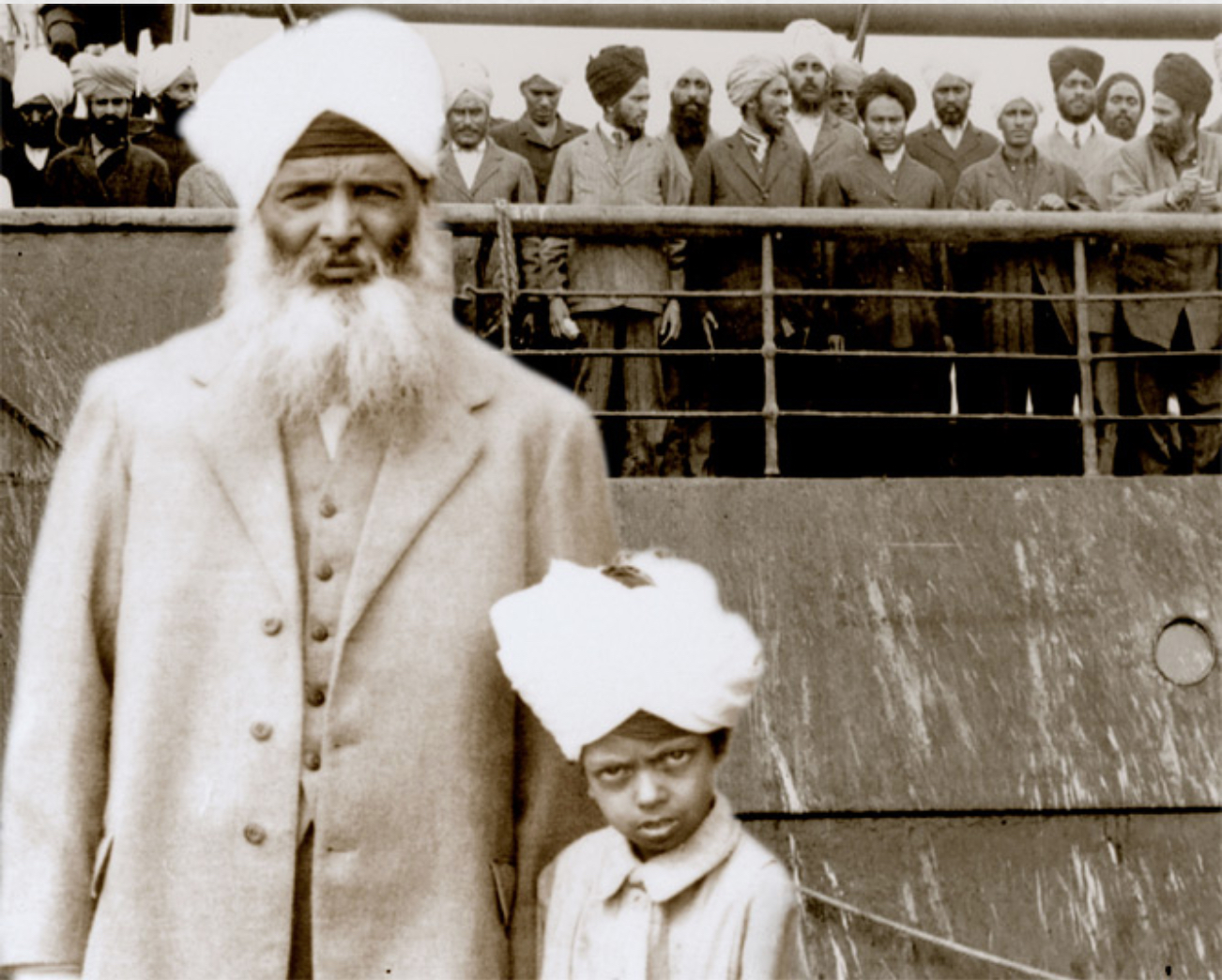 Film still for Continuous Journey showing an old photo of one adult and one young child