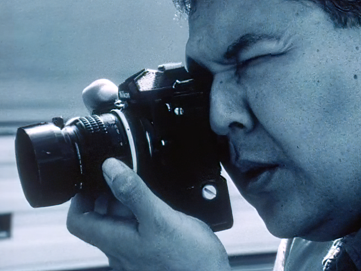 Film still from Shooting Indians showing a person holding a camera